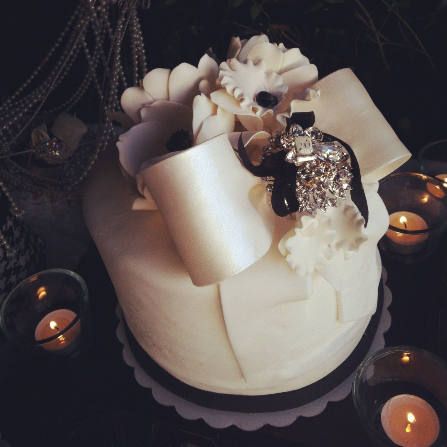 An elegant black and white bridal shower cake by rafius pastry