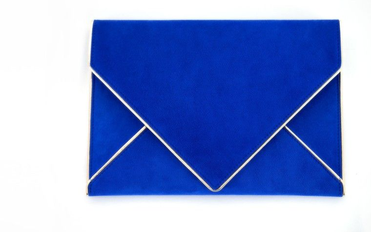 Blue lambskin suede clutch with metallic silver piping.Handcrafted at the Azzaro atelier in Paris, France.