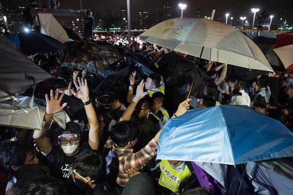 Umbrella Revolution Hong Kong, Pro-democracy protesters clash with police outside the central government offices in the Admiralty district of Hong Kong on October 15, 2014. AFP PHOTO / Ed Jones (Photo credit should read ED JONES/AFP/Getty Images)