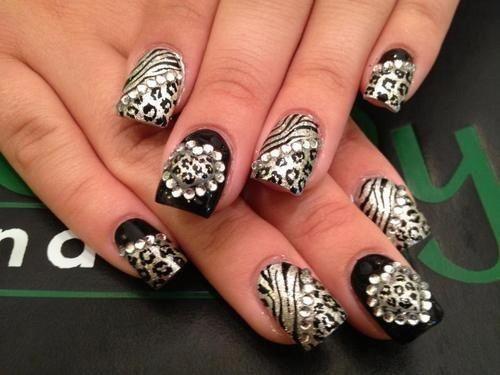 Black & gold animal print nails .