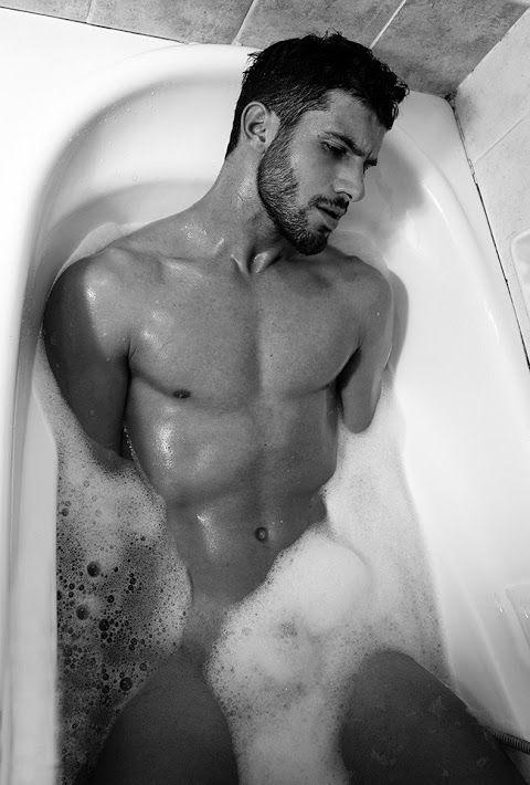 Man in bathtub nude