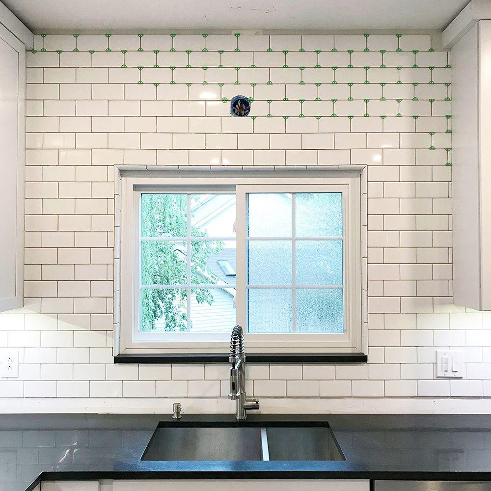 Kitchen Remodel Pt 3 Tiling The Backsplash Kitchen Renovation Tile Around Window Bullnose Tile