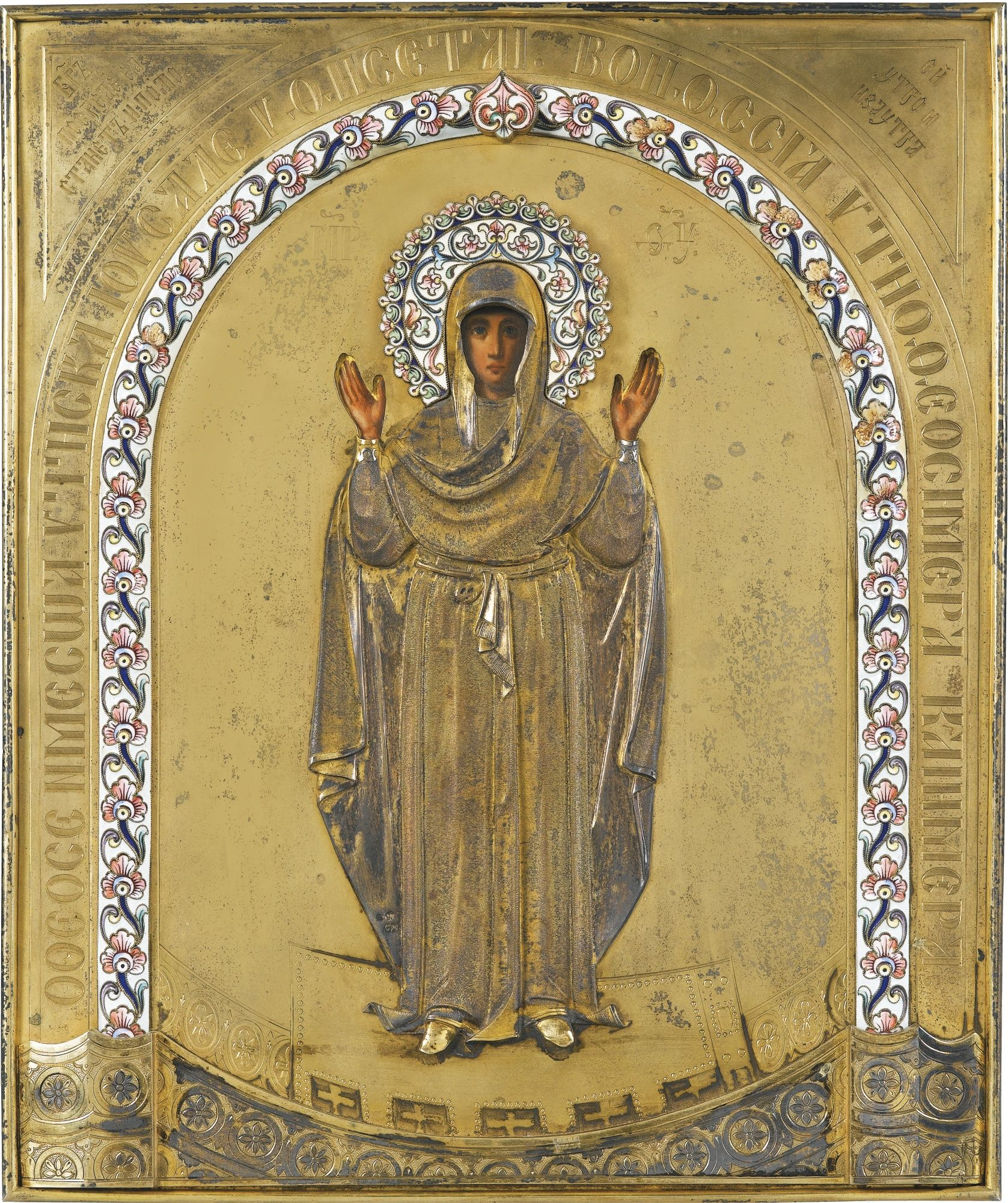 A silver-gilt and cloisonné enamel icon of the Mother of God of the ...