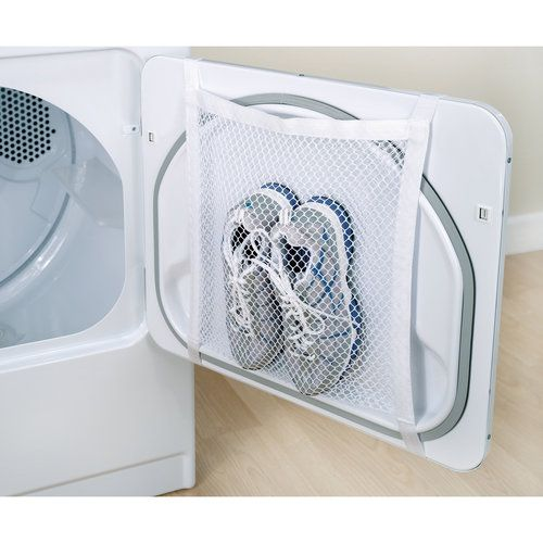 Great trick to keep your shoes clean and prevent them from clunking around your dryer. It might work for delicates too!
