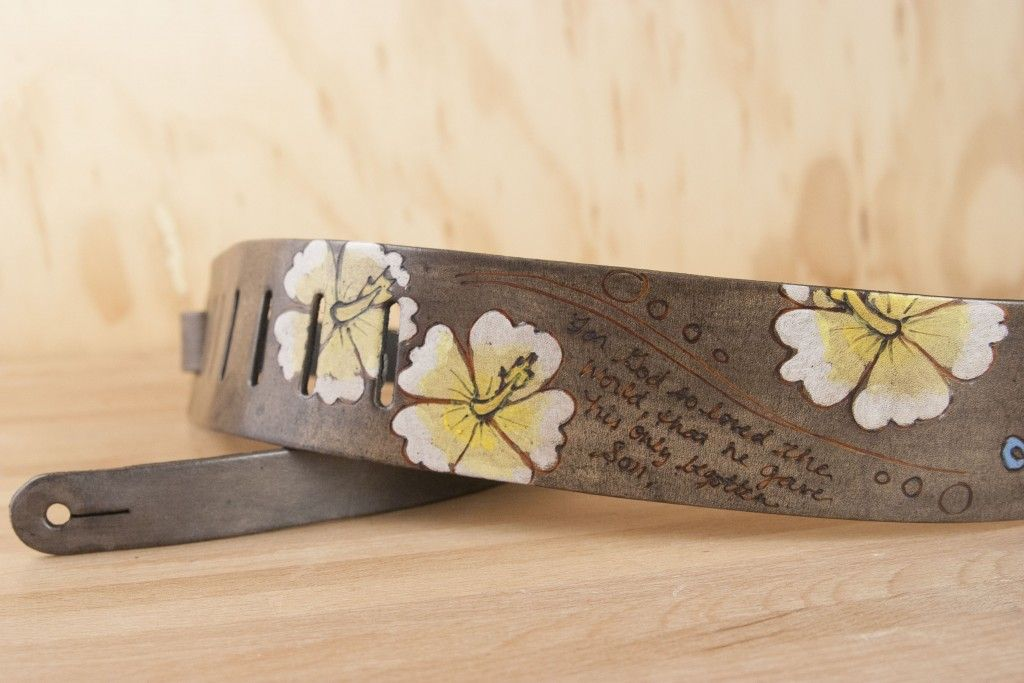 The perfect Hawai'ian combo - little turtles and hibiscus flowers along with a custom inscription create the pattern for this ukulele strap.  It's wider than a traditional ukulele strap so you can enjoy plenty of pattern!