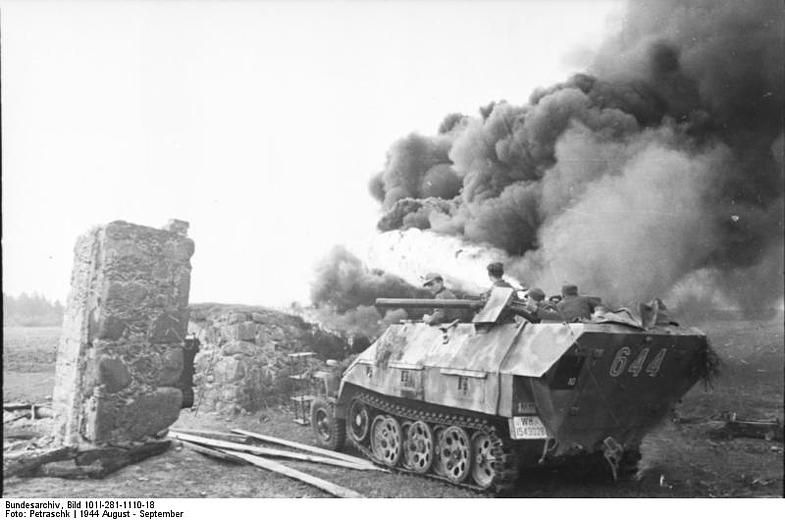 German SdKfz. 251/16 No - 644. halftrack vehicle torching a building with a flamethrower, Russia, Aug 1944,