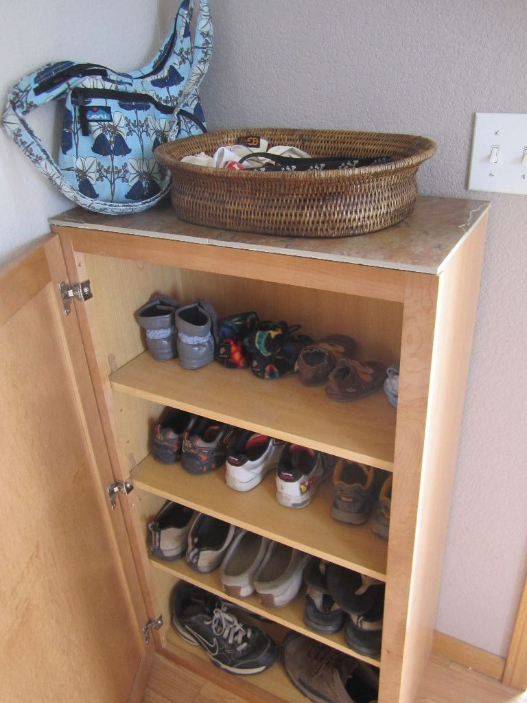 this is a kitchen cabinet from restore and a couple of 12 inch tiles caulked onto the top  so much better than the tiny open shelving     shoe storage by the back door  this is a kitchen cabinet from      rh   pinterest com