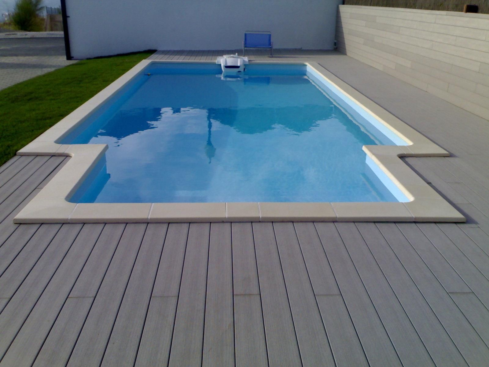 Plastic Wood Looking Decking Around The Swimming Pool