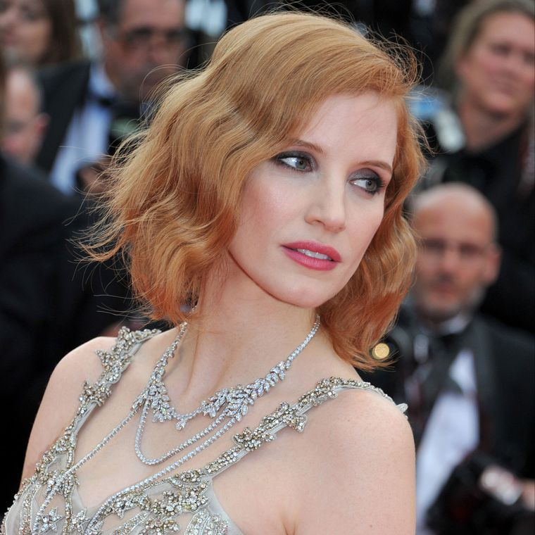 Close-up of Jessica Chastain's Piaget white-gold & diamond sautoir necklace with her Alexander McQueen gown at the 'Money Monster' premiere at Cannes Film Festival 2016.