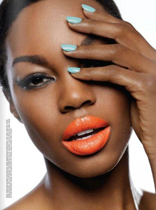 Orange lips on dark skin