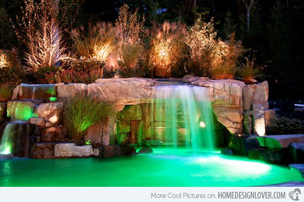 The Colourful Lights Installed Near The Waterfall Highlighted The Continuous Movement Of The Water In The Poo Swimming Pools Backyard Pool Waterfall Cool Pools