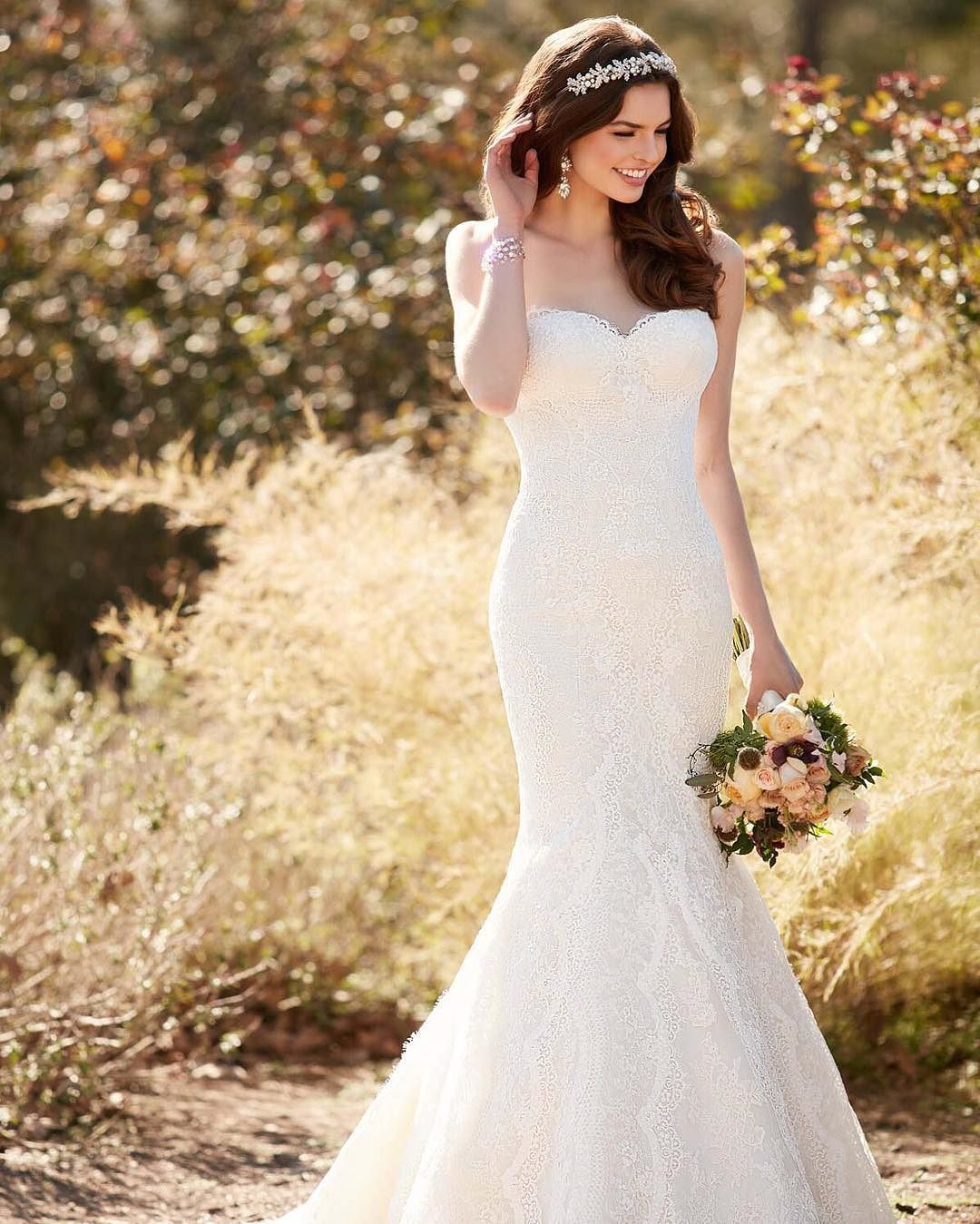 Essense wedding dress  Chapel length train graphic lace sweetheart neckline  what more
