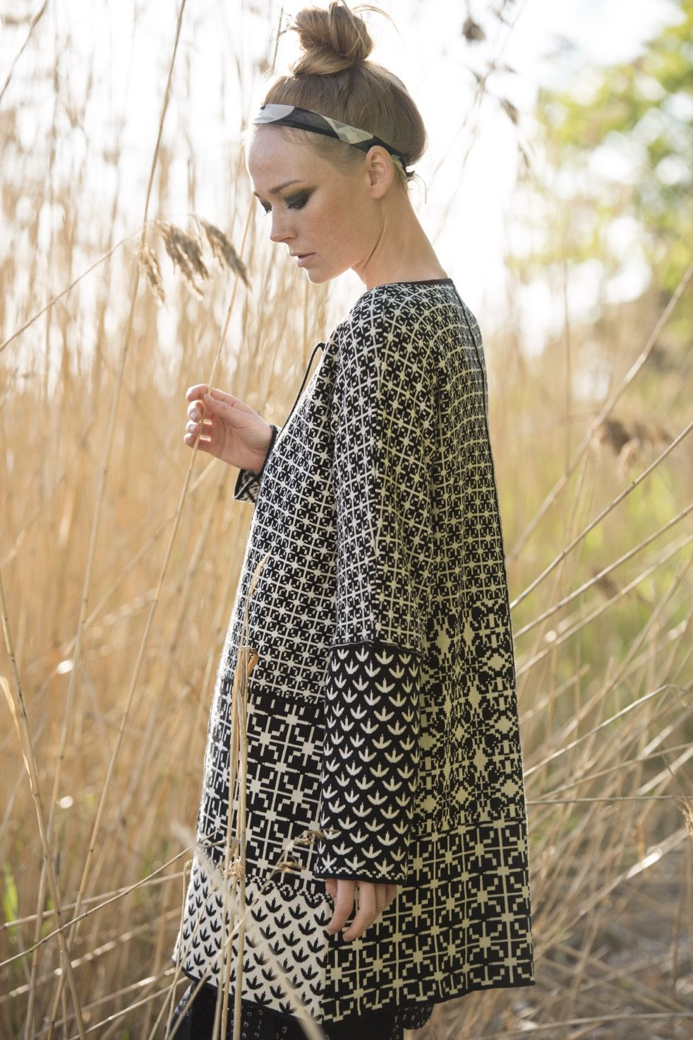"""The knit """"Patch"""" tunic is finely fashioned with jacquard-knit ..."""