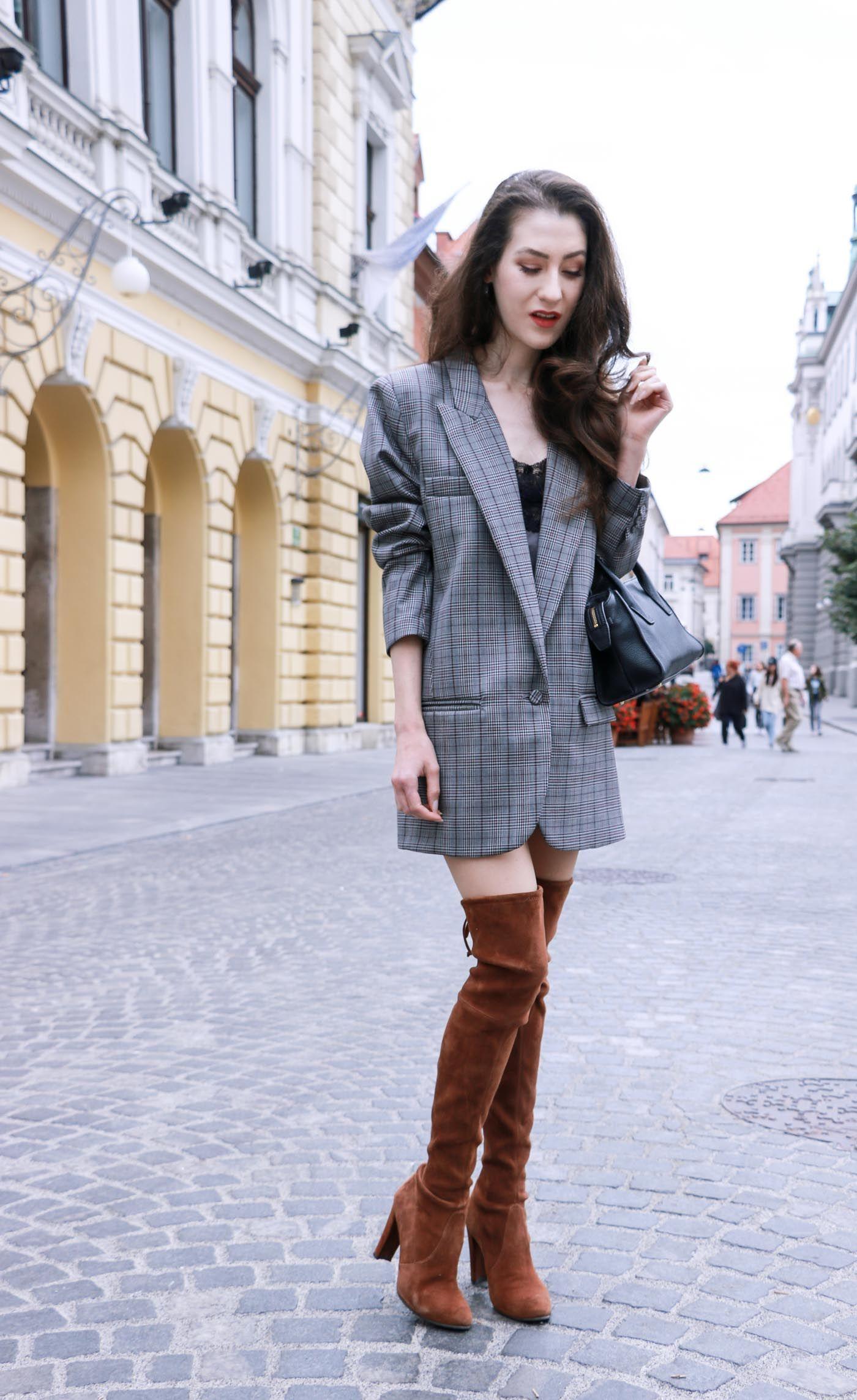 15893e79bc2 Fashion Blogger Veronika Lipar of Brunette from Wall wearing brown Stuart  Weitzman otk boots