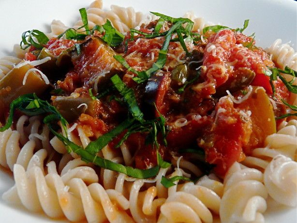 Chunks of eggplant cook in a slow cooked spaghetti sauce