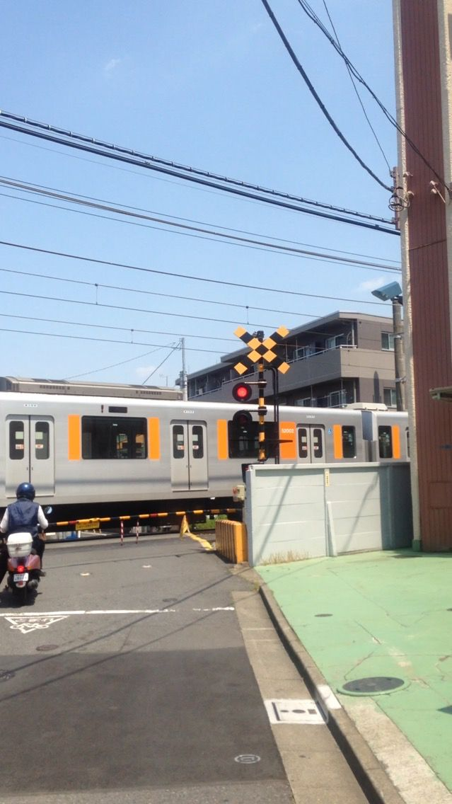 Waiting for train passing in Nerima