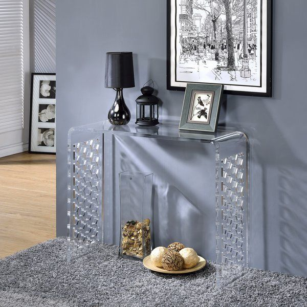 This clear lucite acrylic console table is a beautiful addition to any home or office. Clean lines with attractive honeycomb cutout design and a simple U-shape make it a versatile piece that fits with practically any decor.