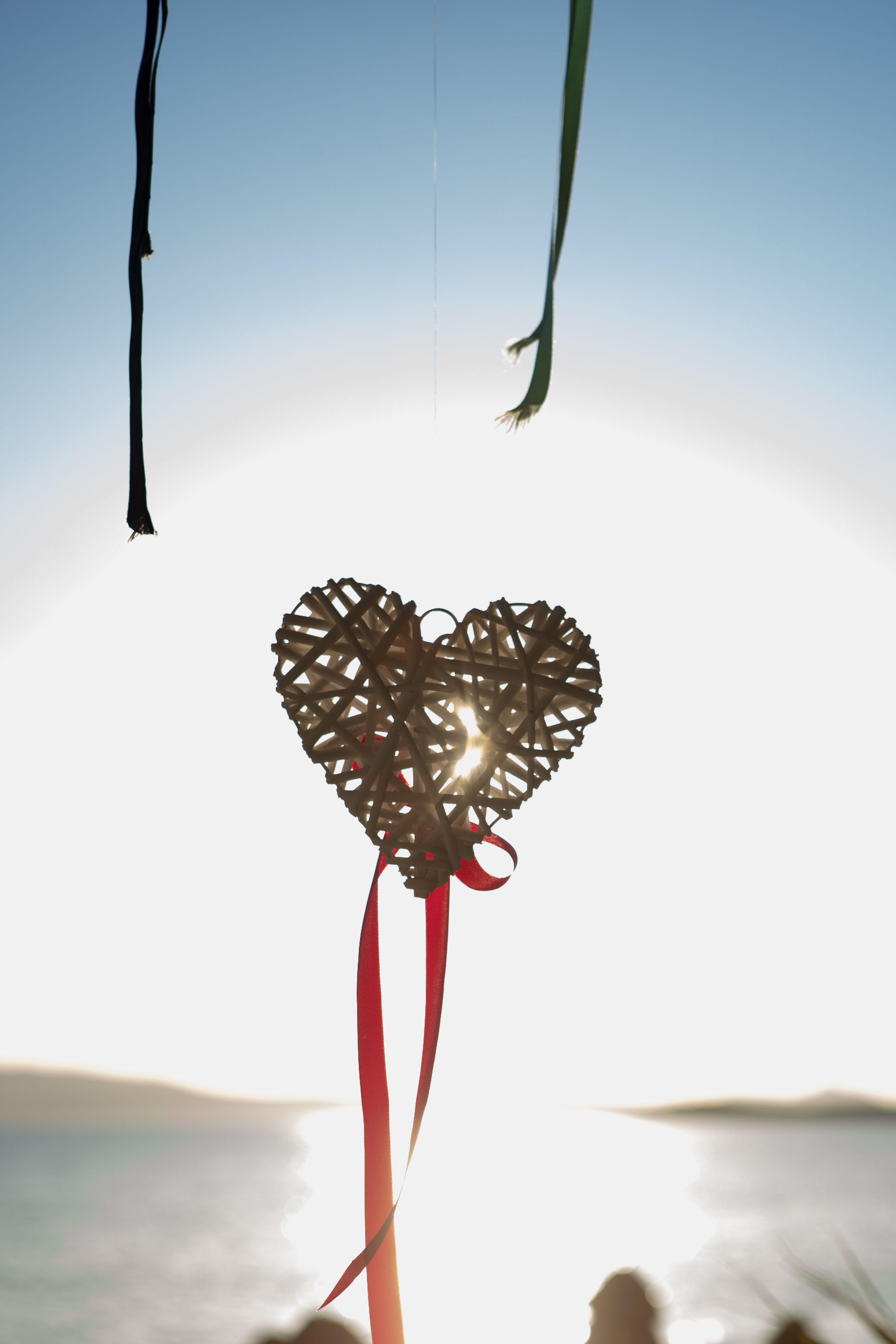 Wedding in Greece.  Naxos Wedding. Beautiful Wooden Hearts with red ribbon. Beach Wedding Decoration.