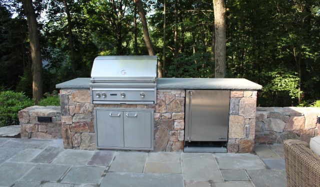 Built In Grill And Outdoor Refrigerator With Freezer.