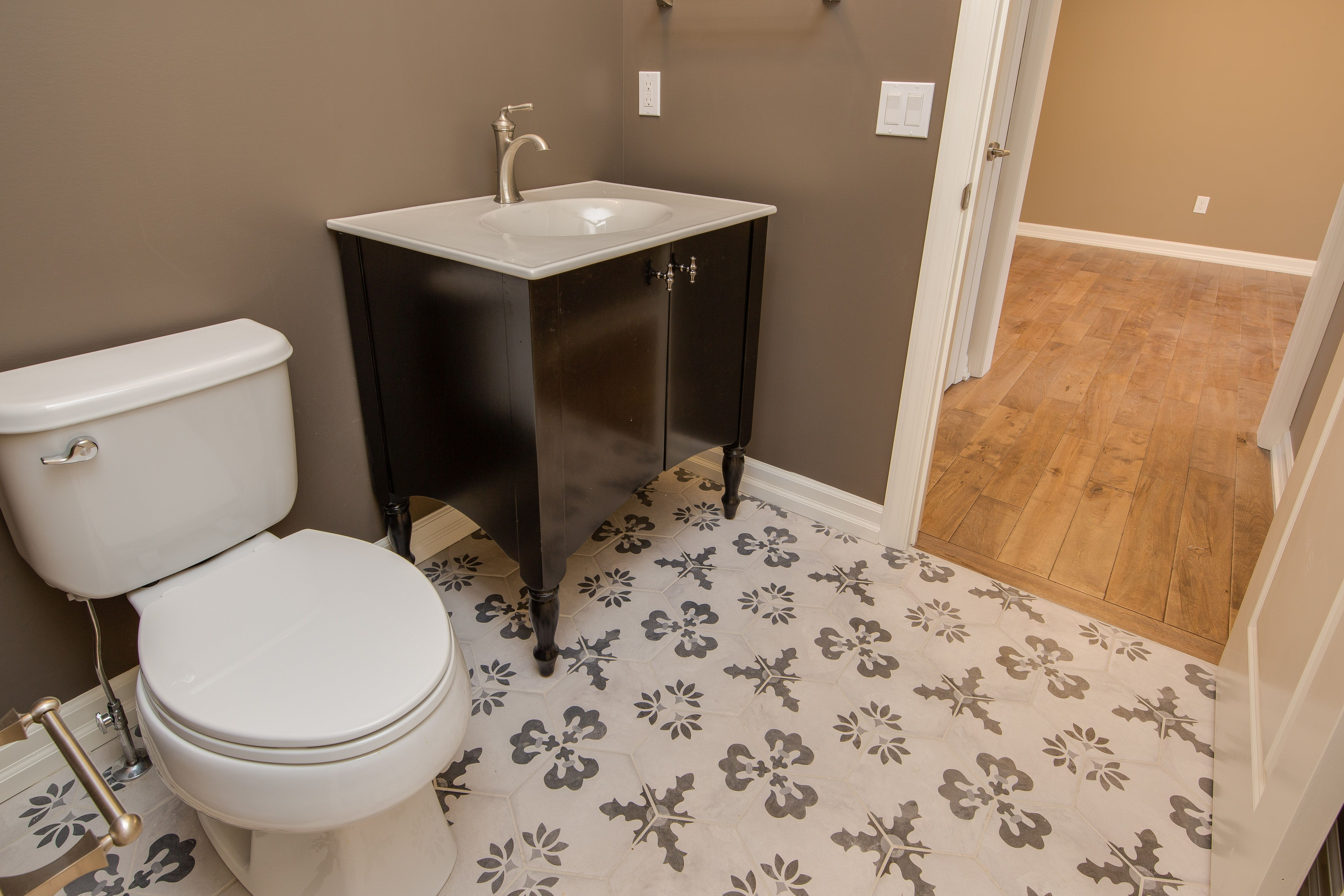 Powder Bath Ceramic Hexagon Deco Tile Floor Stained Vanity Cabinets With Marbelite Counter Top