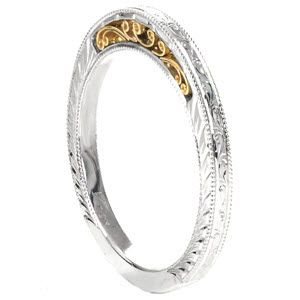 Design 2589 - Design 2589 is a beautiful heirloom wedding band crafted in 14k white gold. Continuous hand engraved scrolls adorn the outside shank. Both ring faces are finished with a single wheat engraved pattern and milgrain edging. Lustrous 14k yellow gold filigree curls add warmth to the design.