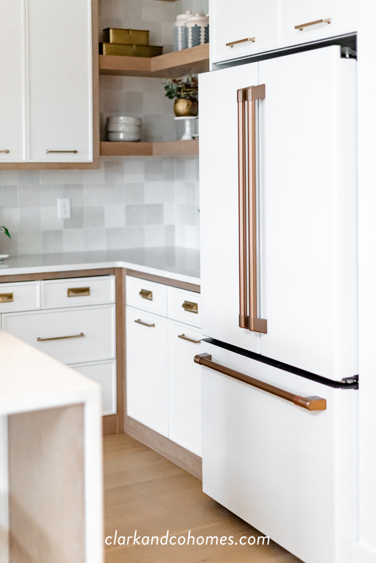 White and brushed brass appliances, like this GE Cafe French door ...