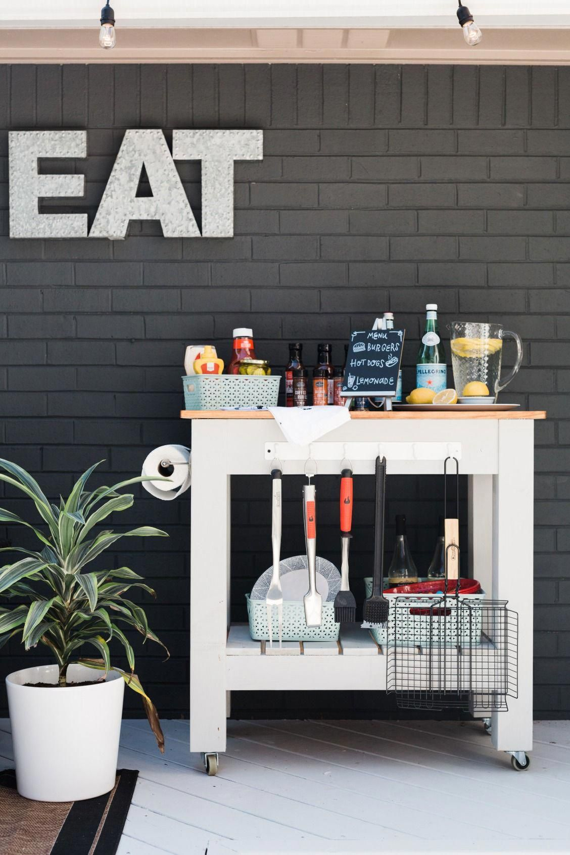diy a grill cart on wheels for ultimate outdoor entertaining adding hooks and baskets on outdoor kitchen on wheels id=51820