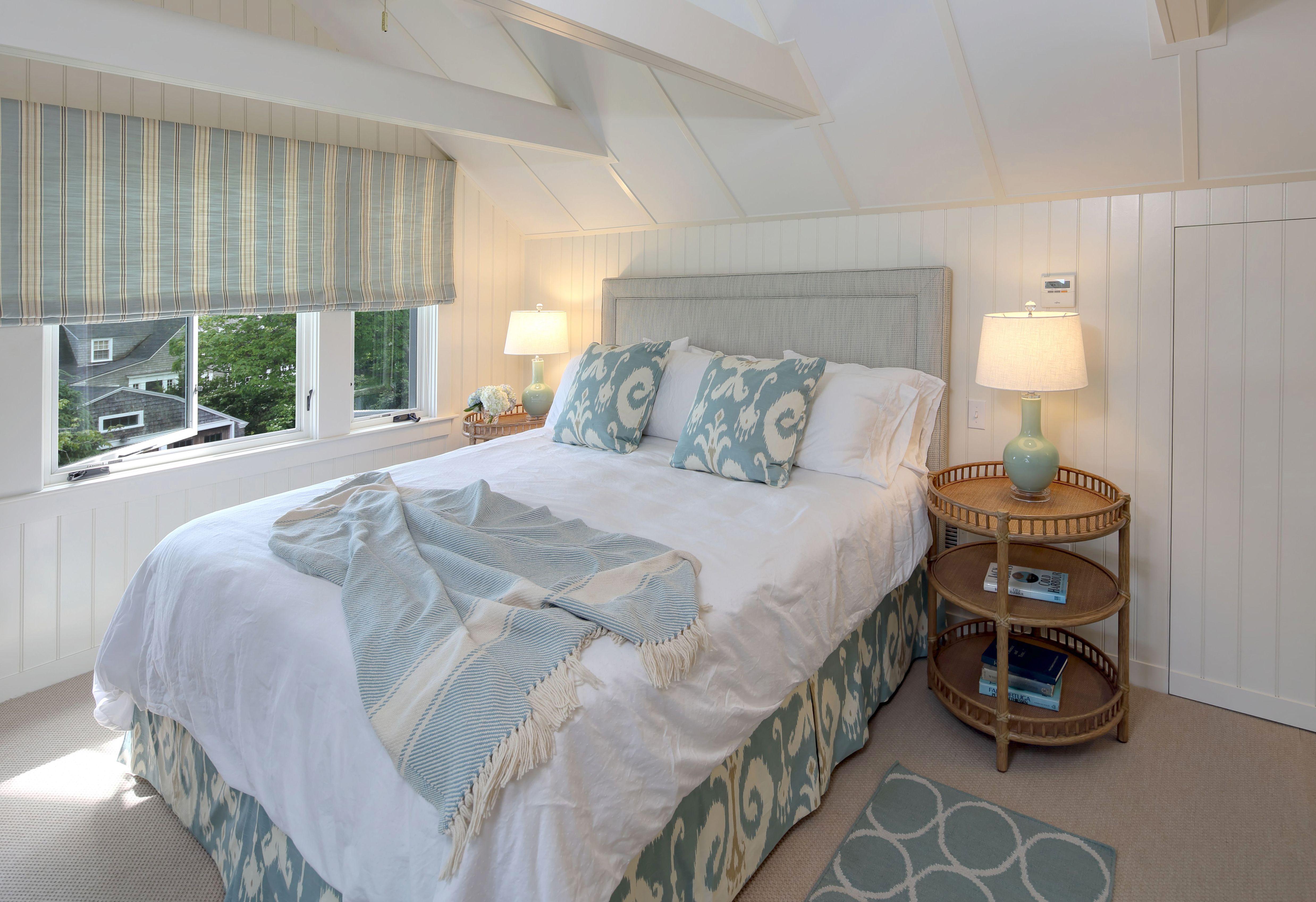 blue master bedroom with ikat print coastal maine interior design
