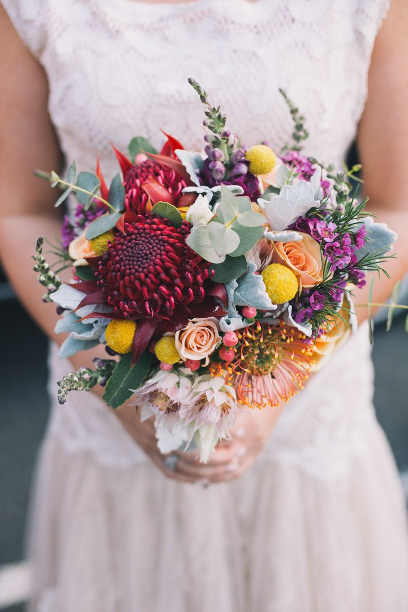 Colourful Bouquet With Australian Natives Roses And Billy Buttons Bridal Bouquet Magenta Wedding Wedding Flowers