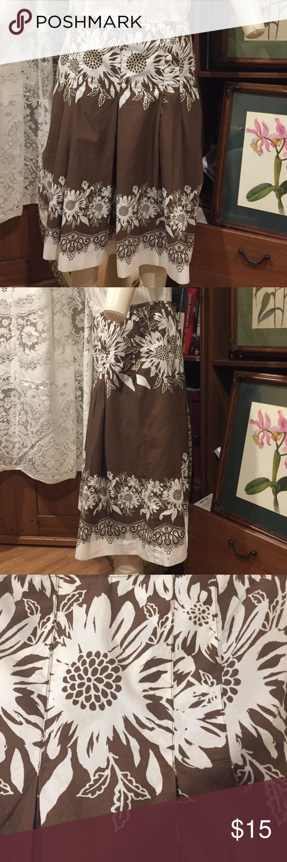 Ann Taylor Loft Brown & White Floral Summer Skirt Ann Taylor Loft Circle Skirt, Color Brown with White Flowers, Size 10, Outer Skirt (shell) is 100% Cotton & Lining is 100% polyester.  This skirt had been worn previously but is in good condition with no apparent rips or stains. Very nice summer or vacation skirt. Please feel free to reach out to me with questions. Ann Taylor Skirts Circle & Skater