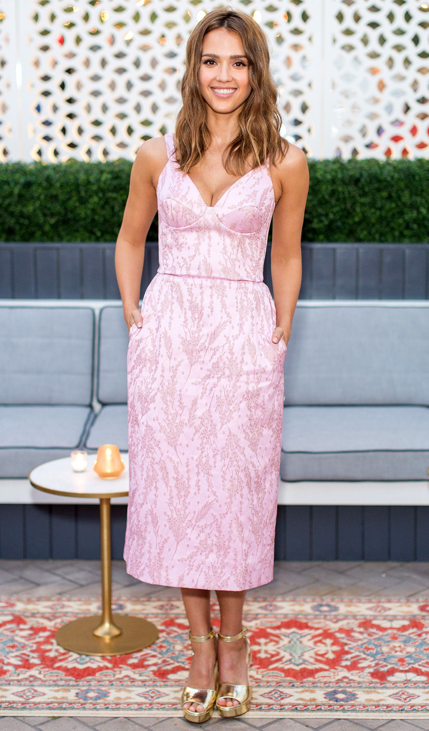 d8dca86ab73 JESSICA ALBA in a pink Ulyana Sergeenko dress with gold Stuart Weitzman  platform heels at an InStyle magazine dinner celebrating Alba s July cover.