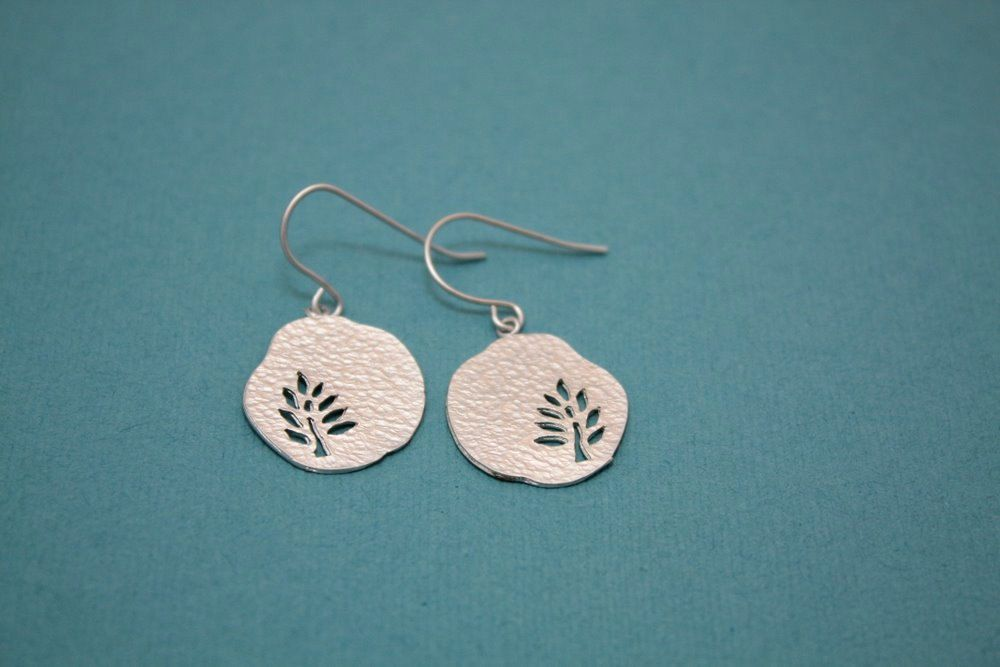 Nature- Silver tree cut out earrings. $16.00, via Etsy.
