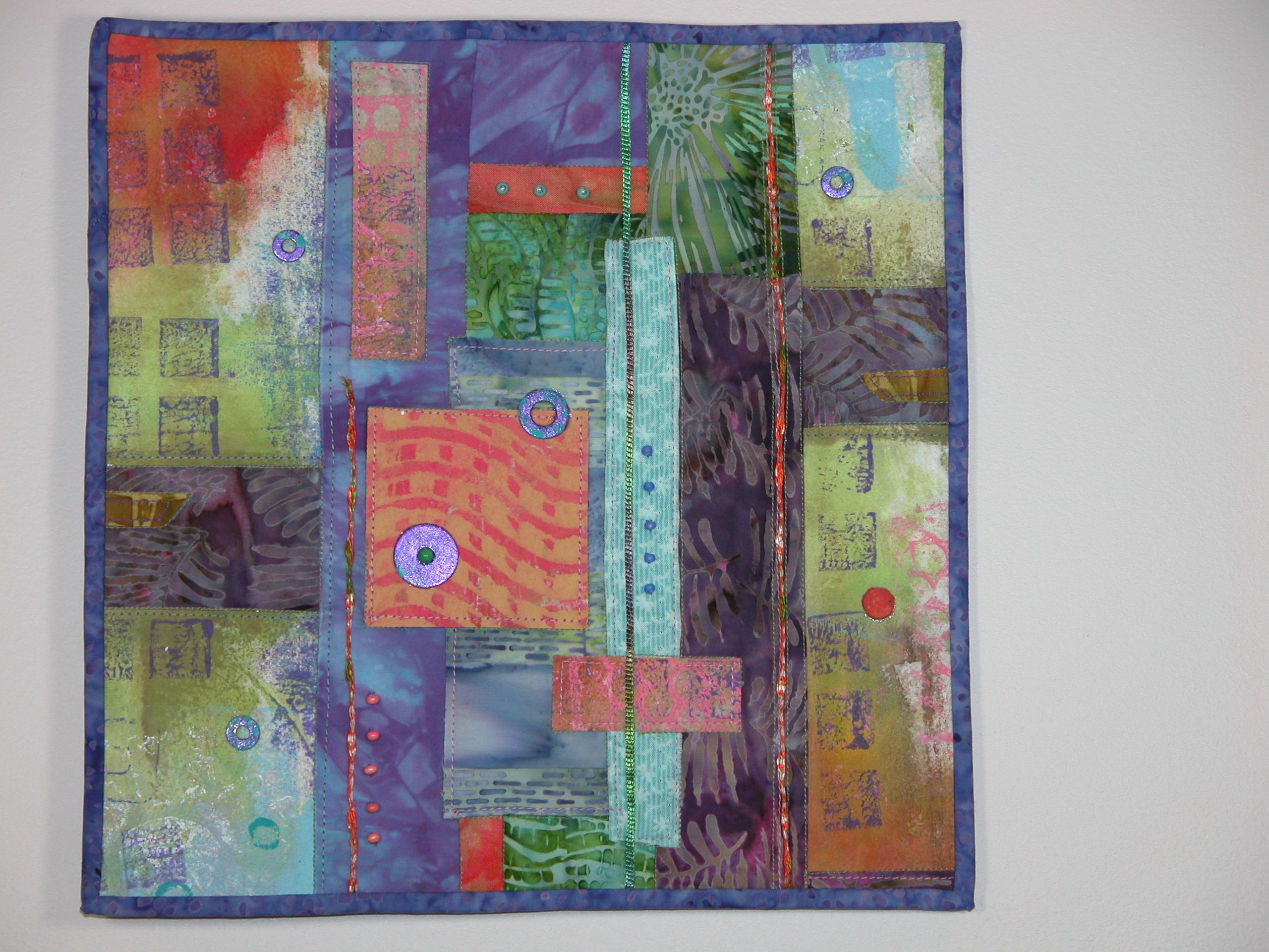 """Exhibited at the International Quilt Study Center March 2014 12""""x 12"""" collage painted, mono printed, hand and machine stitched and embellished with warshers and beads"""