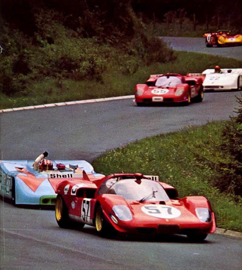 """Jo Siffert furiously signalling Ignazio Giunti."" : (57) Ignazio Giunti / Arturo Merzario - Ferrari 512S Spyder - Ferrari s. p. a. - (20) Jo Siffert / Brian Redman - Porsche 908/03 - John Wyer Automotive Engineering Ltd. - (55) John Surtees / Nino Vaccarella - Ferrari 512S Spyder - Ferrari s. p. a. - ADAC 1000 km-Rennen Nürburgring - 1970 International Championship for Makes, round 7 - Challenge Mondial, round 3"