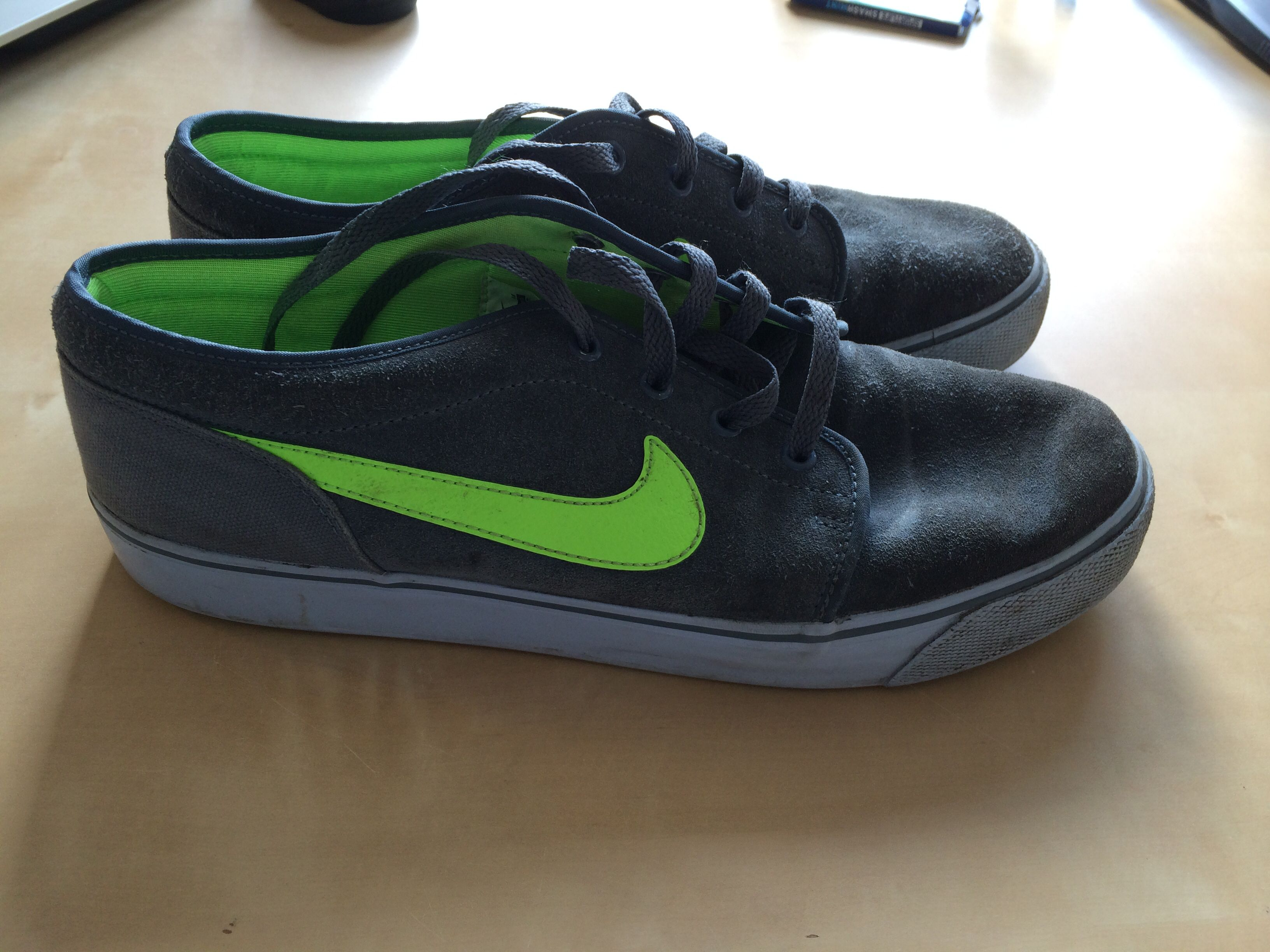 These are my Nike sneakers. What I really like about them are the colour combinations. I like the green and grey. Also are they light weight. So you can easily wear them for a longer time. The were very cheap but still stylish. I bought them about a year ago.