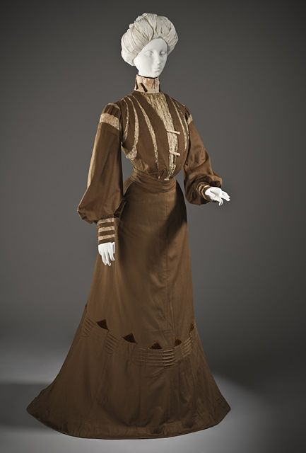 France Woman's Dress, circa 1900 Wool twill, full finish, with linen lace, silk crepe, silk velvet, and cotton plain-weave trim, Center back length A: 18 in. (45.72 cm); Center back length B: 52 1/2 in. (133.35 cm)