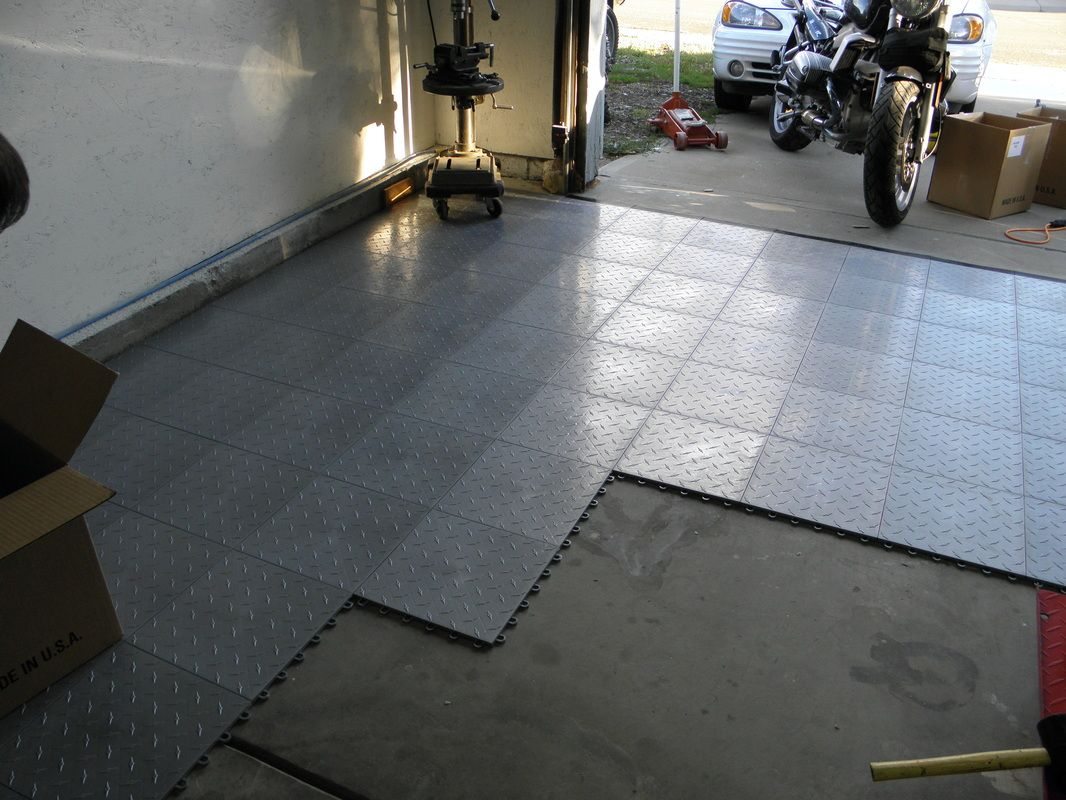 Thejunkmanadv installing truelock garagefloortile motofloor modular garage floor tiles tile flooring was used around the world for centuries where mosaic tile flooring mig dailygadgetfo Images