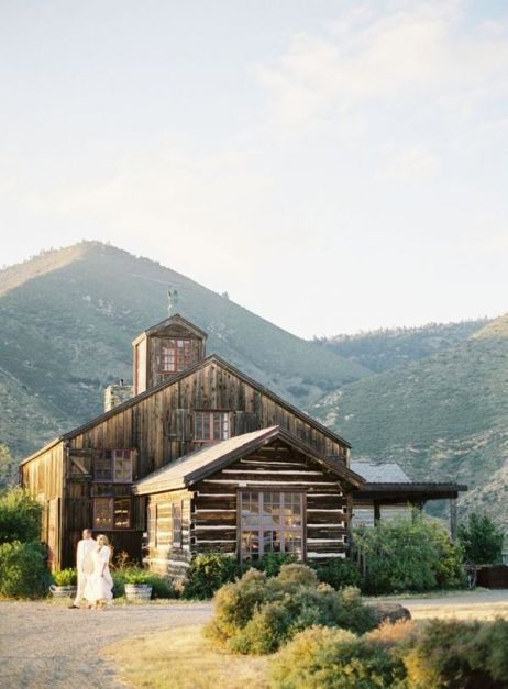 old log cabin house in mountains
