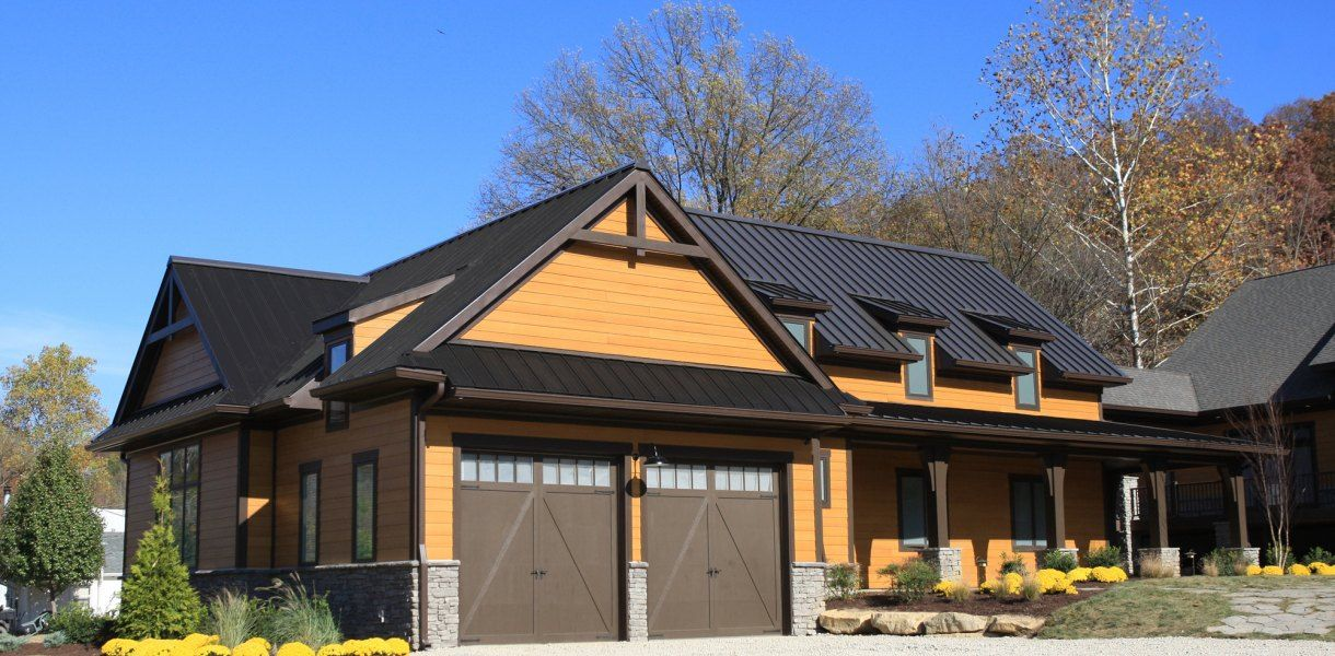 Introducing The Metal Roof Shingles Are Now Obsolete Metal Roof Houses Black Metal Roof House Exterior