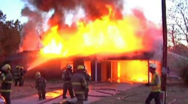 """Texas woman accidentally sets home on fire after finding a snake in the yard. """"While cleaning up, she saw a snake, threw gasoline on the snake, and lit the snake on fire,"""" said Deputy Randall Baggett of the Bowie County Sheriff's Office. """"And the snake went into the brush pile and the brush pile caught the home on fire."""