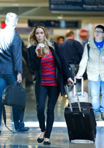 Lauren Conrad Lauren Conrad sips an iced drink at LAX (Los Angeles International Airport).