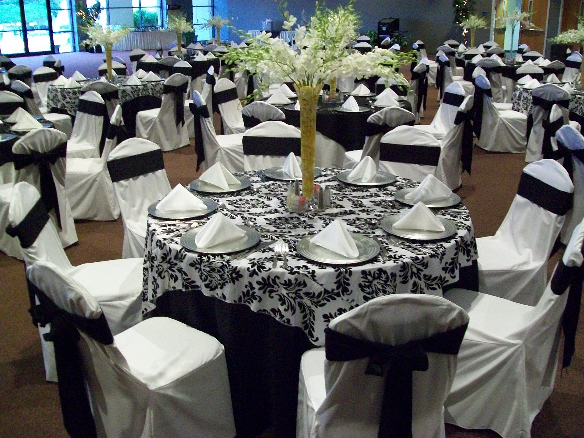 wedding linens Linen Rentals Black and White Flocking Overlay on Black Poly Linen White Chair Covers