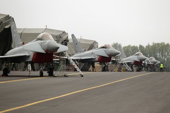 Four Royal Air Force Typhoon jets, which will be used to defend the skies over the Olympic Games, are station outside their temporary hangars at RAF Northolt airbase on May 2, 2012 in London, England.