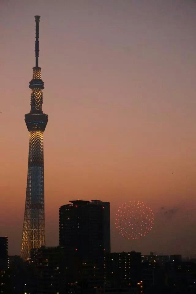 Tokyo skytree and firework at evening.