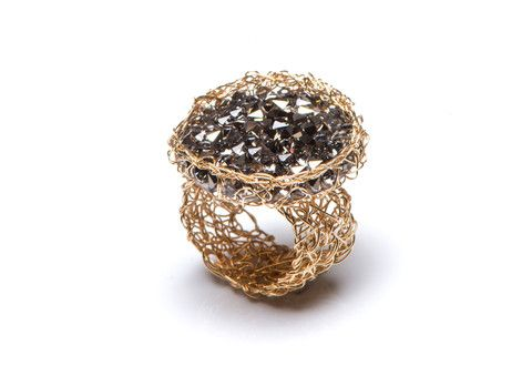 Handmade knitted gold mesh ring with disc of small swarovski crystals.  http://www.pennylevi.com/