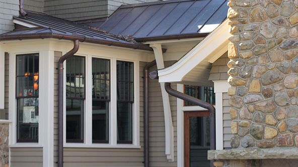 Half Round Gutters And Downspouts Walker Brown Roofing Roof Styles House Exterior Brown Roofs