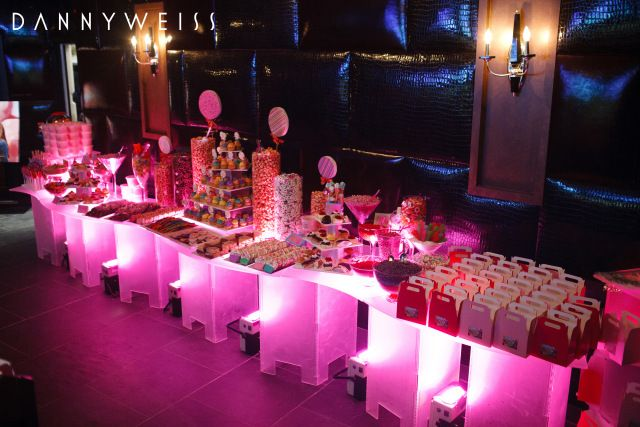 Acrylic bar with pink uplighting, Candy display for party/wedding.