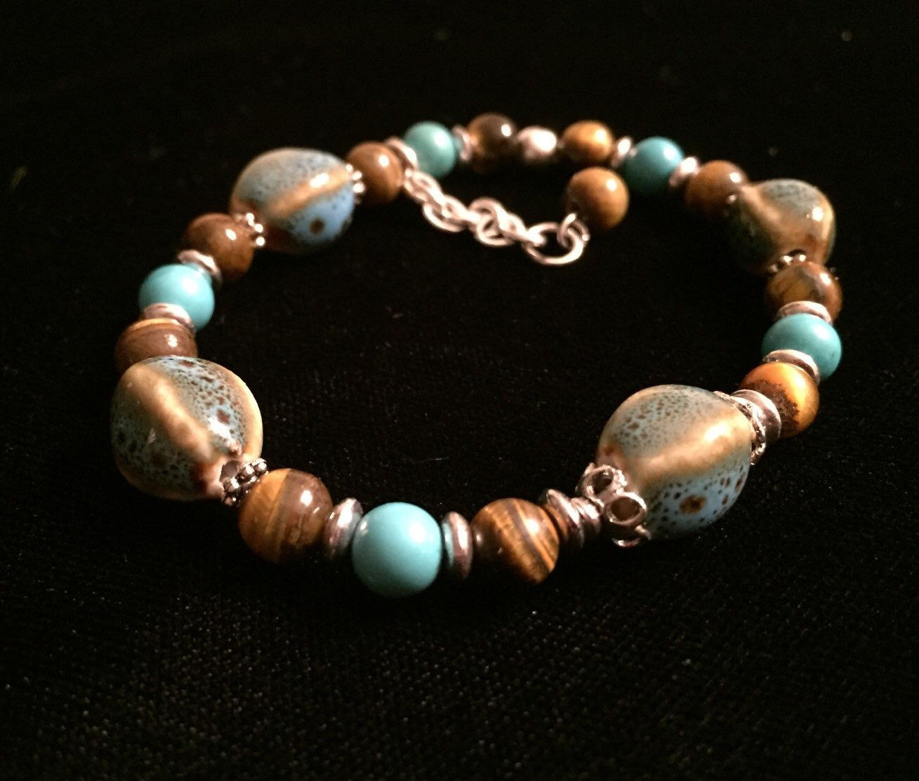 A personal favorite from my Etsy shop https://www.etsy.com/listing/288450233/tigers-eye-and-turquoise-stretch