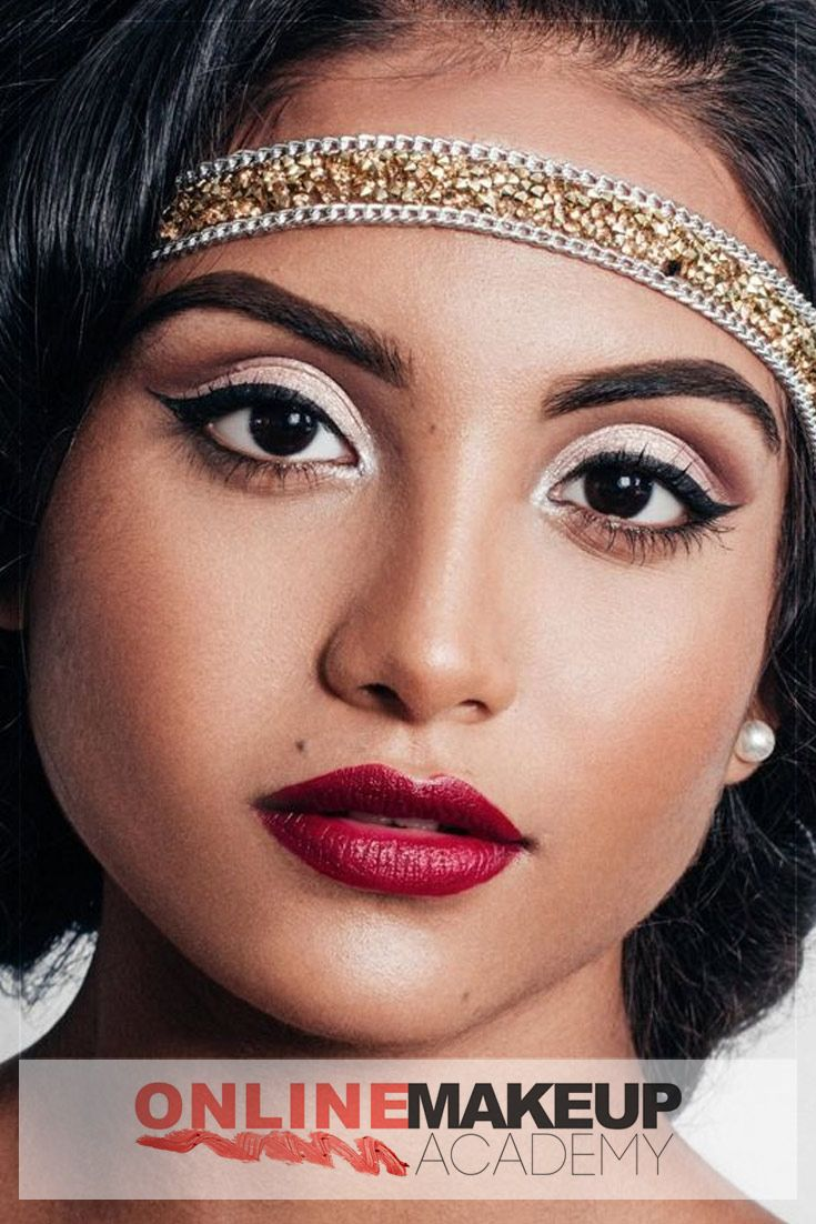 Bold makeup look incorporating structured brows, strong