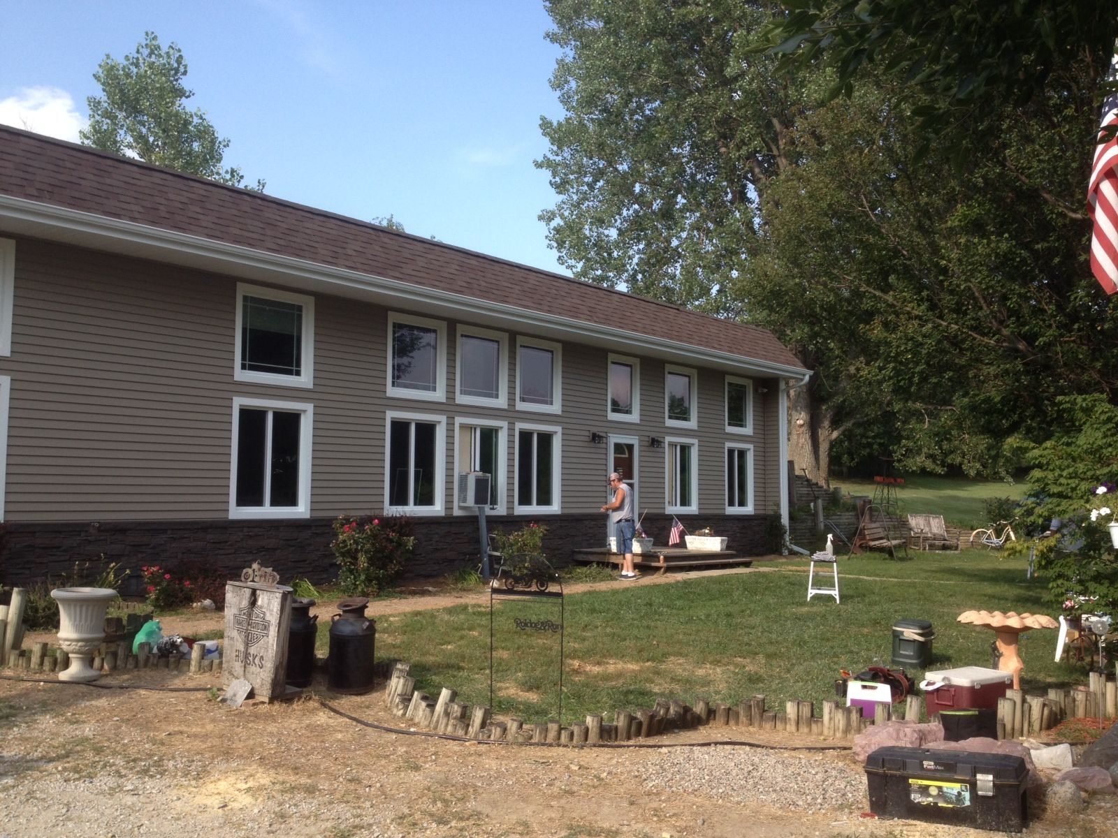 Check Out This Installation Of Mitten Brownstone Siding On One Of Our Customer S Homes What A Beautiful Improvemen Installing Siding House Exterior Brownstone